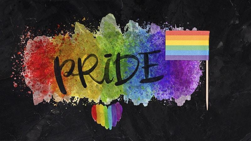 Bandera del orgullo gay con la palabra 'Pride' (orgullo en inglés) diversidad sexual historia LGTB