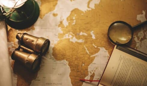 binoculars and magnifying glass on map